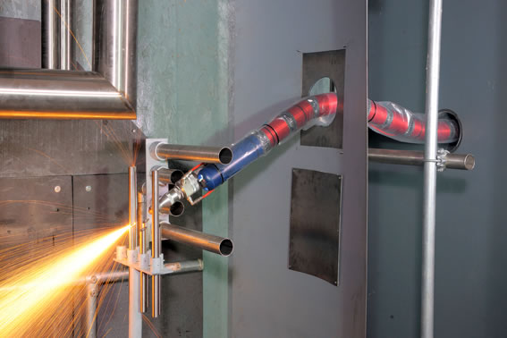 The laser tool of the snake-arm robot can cut through steel like butter. © 2012 OC Robotics